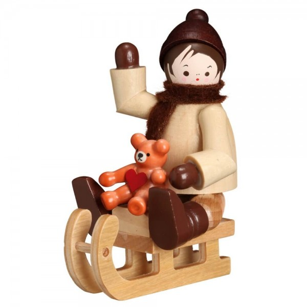 Winterkind mit Teddy auf Schlitten, 6 cm von Romy Thiel