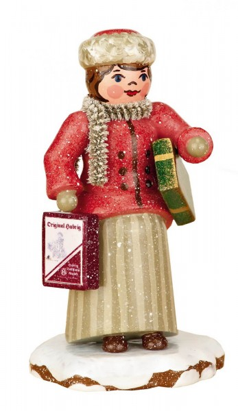 Winterkind Weihnachtseinkäufe von Hubrig Volkskunst GmbH Zschorlau/ Erzgebirge ist 7,5 cm groß.