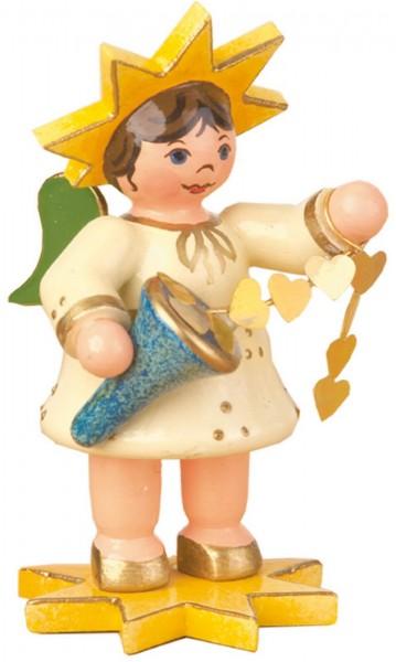 Weihnachtsfigur Sternkind mit Herzband von Hubrig Volkskunst GmbH Zschorlau/ Erzgebirge ist 5 cm groß.