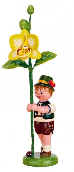 Junge mit Orchidee aus der Serie Hubrig Blumenkinder aus Holz
