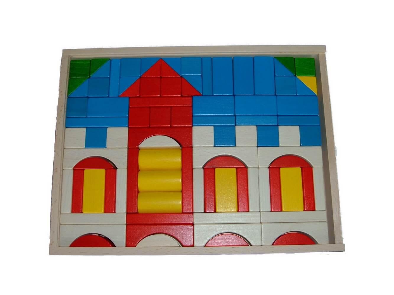 """Mit dem Baukasten """"Schloß"""" können auch schon die Kleinsten ein variantenreiches Bauen erleben. Die 91 Bausteine teils farbig, teils farblos lackiert …"""