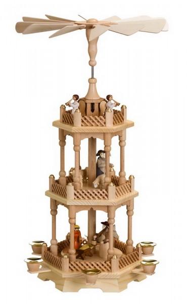 Weihnachtspyramide, 3 - stöckig mit Heiliger Familie, 56 cm. Auf der unteren Ebene dreht sich die Heilige Familie mit dem Kind auf der 2. Ebene drehen sich …