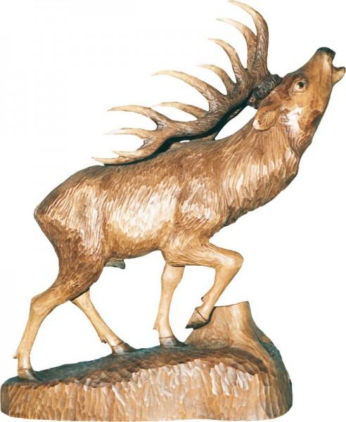Hirsch mit angehobenem Bein, gebeizt, geschnitzt, in verschiedenen Größen