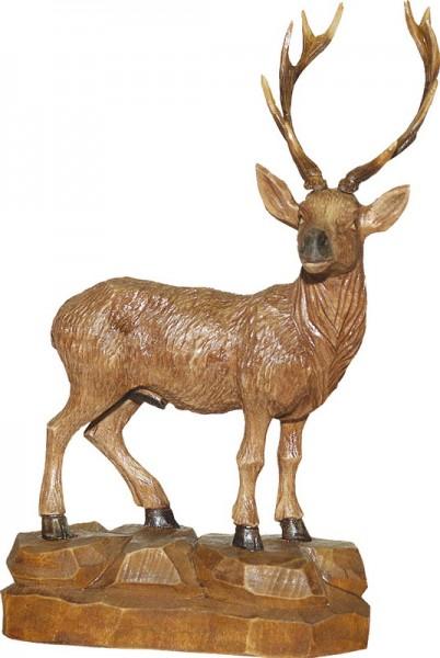 Hirsch mit gedrehtem Kopf, gebeizt, geschnitzt, in verschiedenen Größen