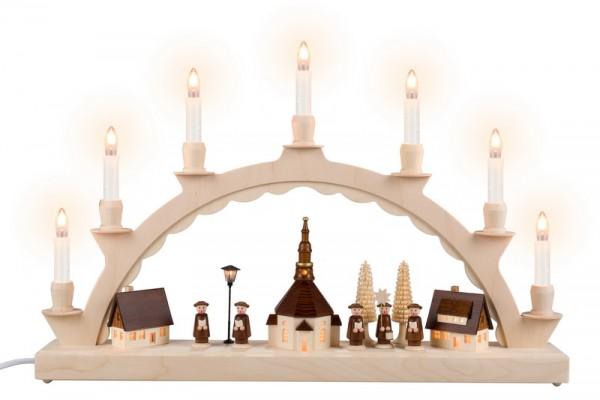 Schwibbogen Seiffener Dorf mit Kurrende und beleuchteter Straßenlaterne und beleuchteter Kirchturmuhr, komplett elektrisch beleuchtet, lange Kerzen, 50 x 32 …