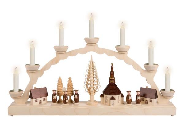 Schwibbogen von Nestler-Seiffen mit dem Motiv Seiffener Dorf mit Kurrende, beleuchtet von Lumix LED Kerzen_Bild1