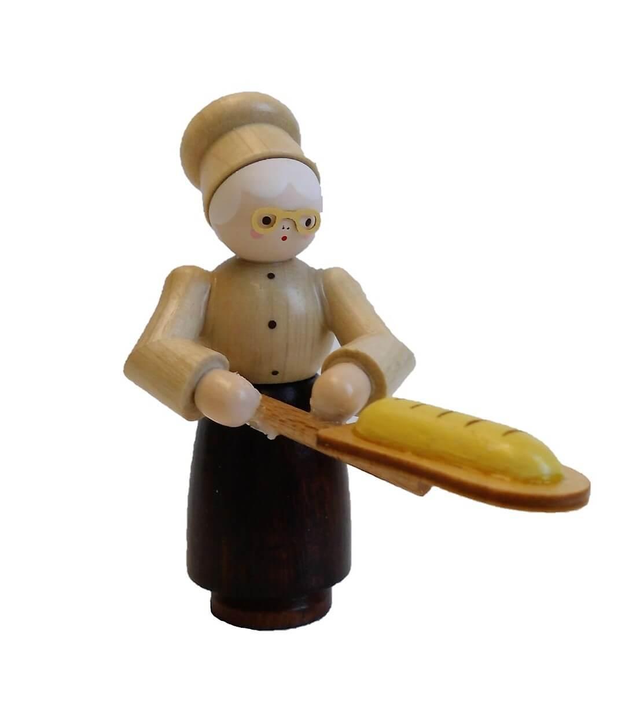 Oma mit Brotschaufel in natur von Romy ThielDeutschneudorf/ Erzgebirge, gehört, durch die detailverliebte Herstellung, mit zu den …