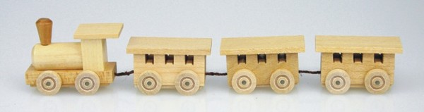 Mini - Holzeisenbahn in natur vonStephan Kaden holz.kunst Seiffen/Erzgebirge. Die Lok gibt den Antrieb und transportiert drei Wagons durchs …
