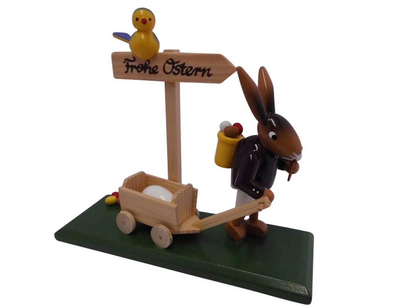Osterhase mit Handwagen aus Birkenholz, farbig bemalt, er zieht einen Wagen voller bunter Ostereier, 12 cm von Nestler-Seiffen.com OHG Seiffen/ Erzgebirge