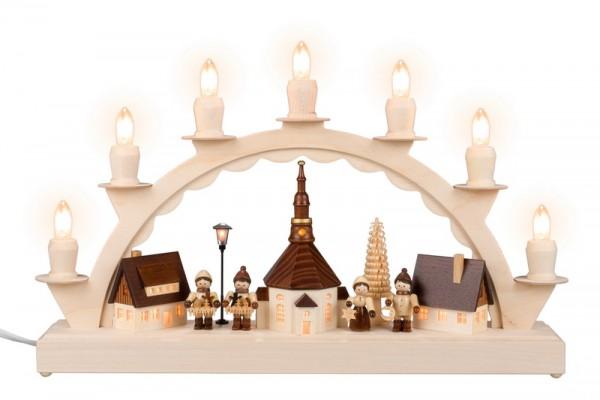 Schwibbogen Seiffener Dorf mit Kinder und Straßenlaterne und Kirchturmuhr, 7 Kerzen, komplett elektrisch beleuchtet, 38 cm x 23 cm, Nestler-Seiffen.com OHG …