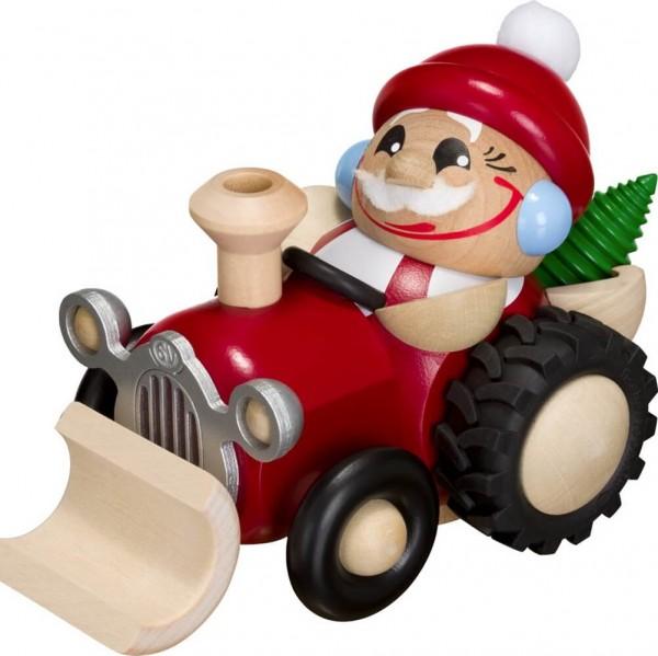 Lustige Räucherfigur mit Baum im Traktor