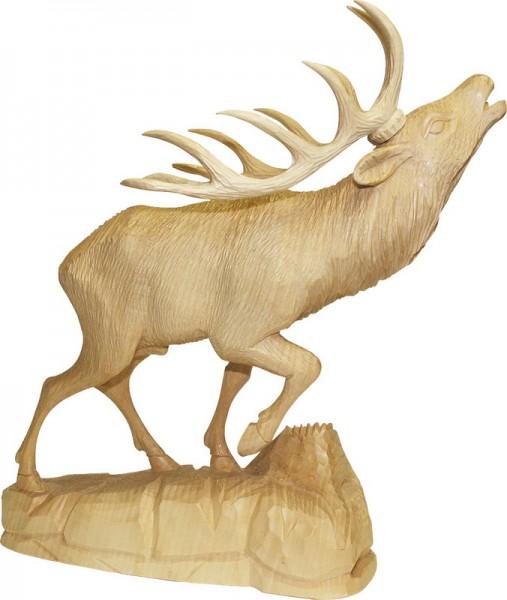 Hirsch mit angehobenem Bein, nature, geschnitzt, in verschiedenen Größen