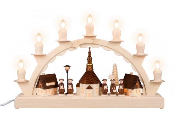 Schwibbogen Seiffener Dorf mit Kurrende und Straßenlaterne und beleuchteter Kirchturmuhr, 7 Kerzen, komplett elektrisch beleuchtet, 38 cm x 23 cm, …
