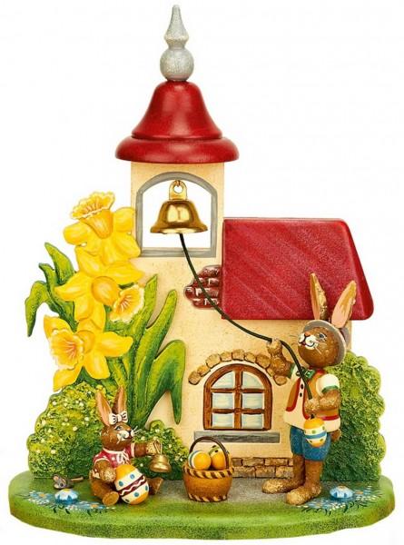 Osterhase aus Holz läutet die Glocke von der Serie Hubrig Osterhasen