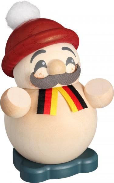 lustiger kleiner Räuchermann, typisch deutsch, mit Schal und Mütze