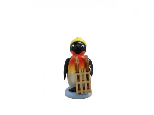 Pinguin von Nestler-Seiffen mit Schlitten, farbig
