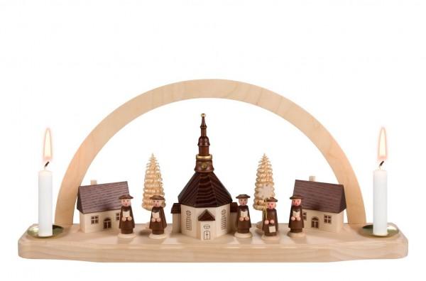 Schwibbogen von Nestler-Seiffen mit dem Motiv der Seiffener Kirche, beleuchtet mit Wachskerzen_Bild1