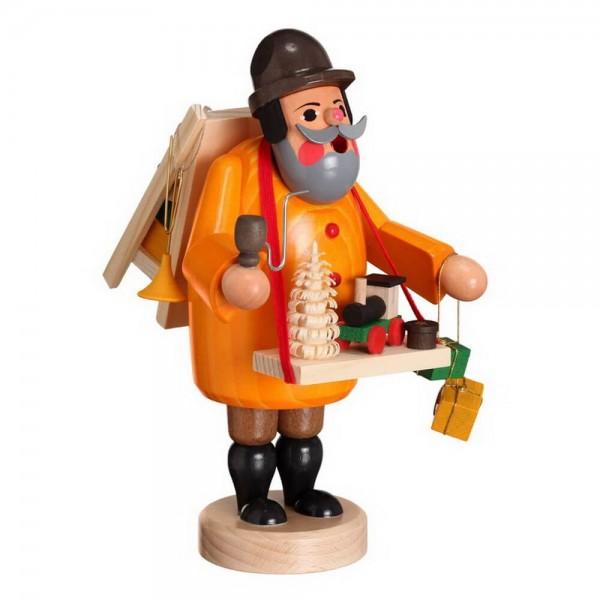 Räuchermann Spielzeughändler von Karl Werner Sayda / Erzgebirge Der Spielzeughändler bietet seine Waren feil. In seiner orangefarbenen Jacke fällt er überall …