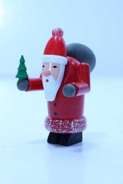 Dekofigur Weihnachtsmann mit Baum und Geschenkesack