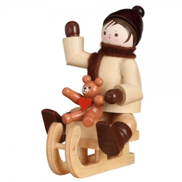 Romy Thiel, Winterkind mit Teddy auf Schlitten