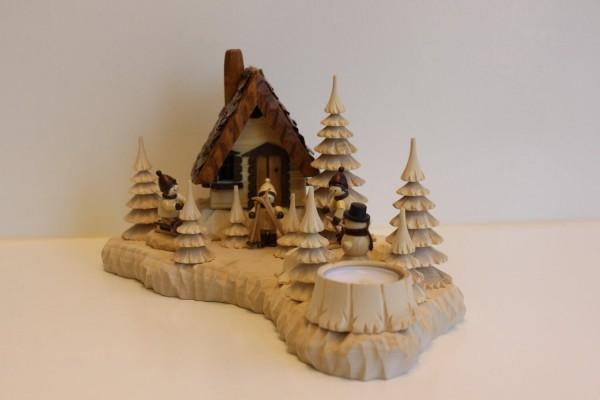Das Räucherhaus Wildhüterhütte mit Teelicht und den Romy Thiel Winterkindern, von Holzdrechslerei A. Lahl Deutschneudorf/ Erzgebirge, ist ein begehrtes …