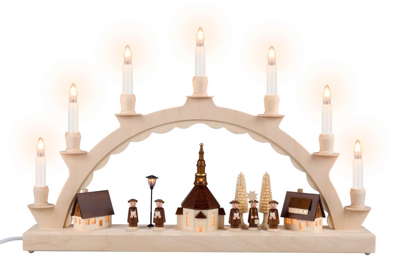 Schwibbogen von Nestler-Seiffen mit Seiffener Dorf und Kurrende und beleuchteter Straßenlaterne und Kirchturmuhr_Bild1