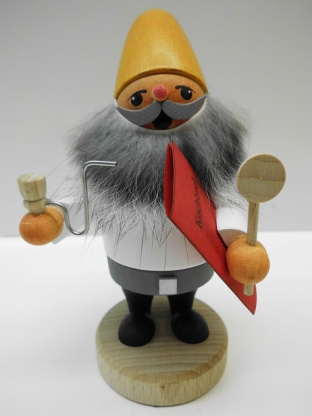 Räuchermännchen Zwerg mit Kochbuch von Karl Werner Sayda / Erzgebirge Ein Zwerg oder auch Wichtel als Koch. Er trägt eine gelbe Zipfelmütze und hat einen …