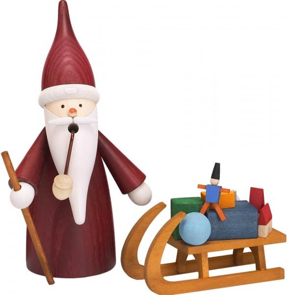 Der Räuchermann Weihnachtswichtel mit Schlitten, 16 cm von Seiffener Volkskunst eG Seiffen/ Erzgebirge. Er gehört zur Räuchermann Serie …