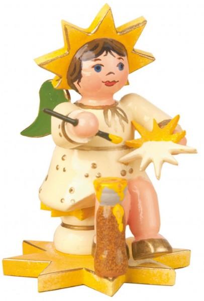 Weihnachtsfigur Sternkind Sternmaler von Hubrig Volkskunst GmbH Zschorlau/ Erzgebirge ist 5 cm groß.