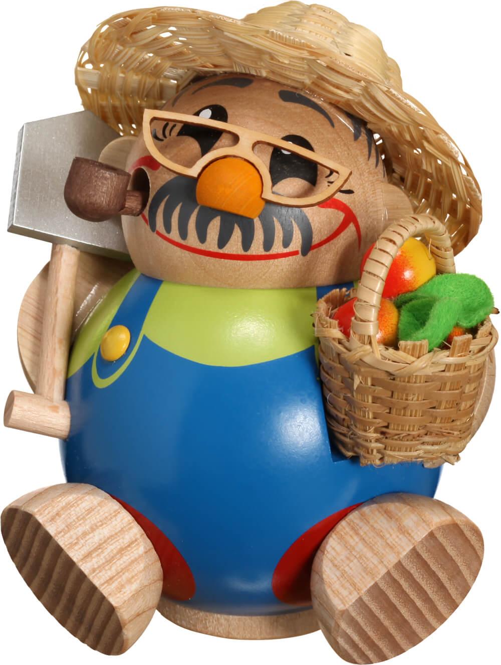 lustige Räucherfigur mit Schaufel und Obstkorb