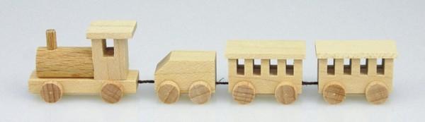 Mini - Holzeisenbahn in natur von Stephan Kaden holz.kunst Seiffen/Erzgebirge. Die Lok gibt den Antrieb und transportiert den Tender und zwei Wagons durchs …